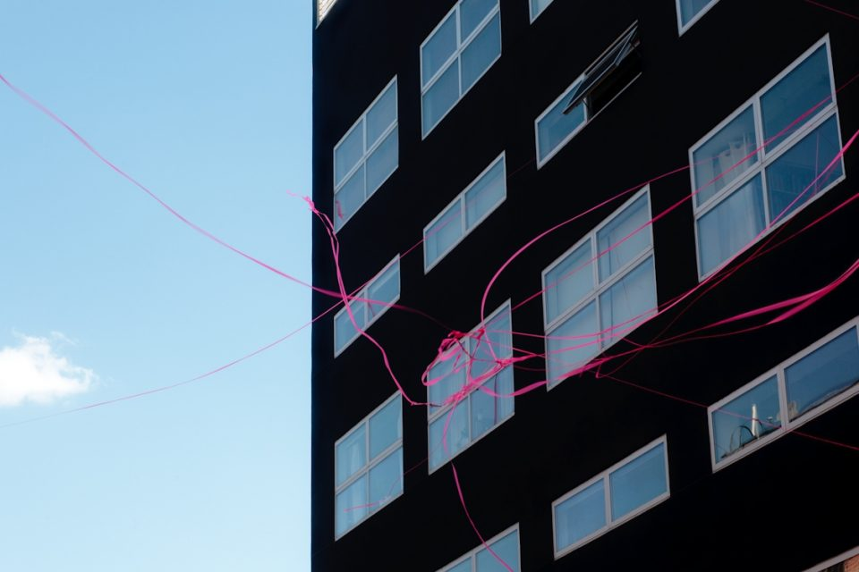 Black Building With Ribbon, a photo by Amber Sexton